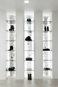 Shoe - accessories display with indirect lighting. Elle store by Emanuele Svetti | More on: www.pinterest.com/AnkApin/stores