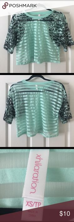 Xhiliration Mint Green Striped Sheer Crop -size XS Xhiliration Mint Green Striped Sheer Crop -size XS; in great condition; only worn once; cropped, boxy fit; perfect with high waist jeans or pants; stripes alternate solid and sheer with a black floral pattern on the sleeves/shoulders Xhilaration Tops Crop Tops