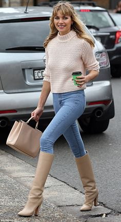 Peachy cheeks! Jessica Hart flaunted her pert derrière in a pair of skin-tight jeans and cream knee-high boots during a morning coffee run in Sydney on Saturday