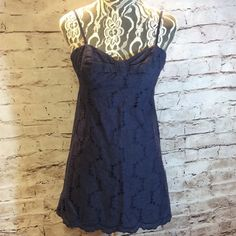 ❌FINAL PRICE❌LILLY PULITZER NAVY EYELET DRESS Pretty navy dress with thin adjustable straps, side zip and scalloped edges.  Some threads have came loose at the bottom that will require mending but can be repaired by someone who can sew. Everything else is in tip top shape Lilly Pulitzer Dresses Mini