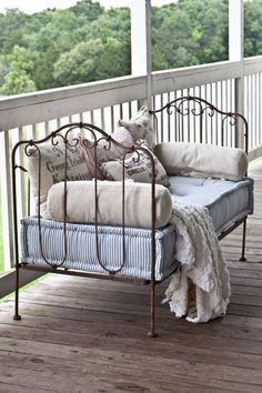 antique French baby crib repurposed as settee...love this