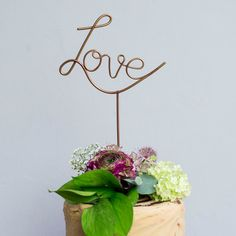 Stylish Love cake topper or a unique accessory to add to a bouquet, for all…