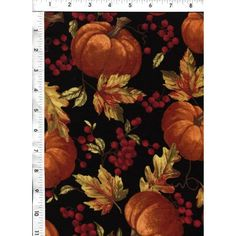 These harvest pumpkins and beautiful fall leaves are scattered across a dramatic black background. www.americasbestthreads.com