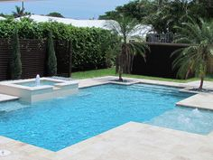 Pool Builders, Inc. - Contemporary Swimming Pool and Spa with Fountain in Manalapan, Florida | by PoolBuilders,Inc