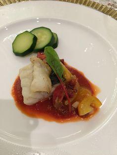 鱸のローストとイベリコ豚のチョリソ風味 完熟トマトのクーリとエシャロットのソースで