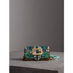 Burberry The Small Buckle Bag in Riveted Snakeskin and Floral Print ($2,495) ❤ liked on Polyvore featuring bags, handbags, flower purse, floral print handbags, flower handbags, burberry handbags and burberry purses