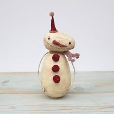 Snowman Christmas Folk Art Primitive Holiday Decoration. $49.50, via Etsy.