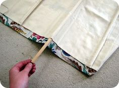 DIY roman shade. Also a good tutorial, but a little more work. Not sure which one I'll use!