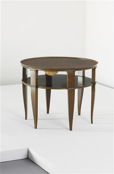 GIO PONTI Occasional table, c. 1930  Walnut-veneered wood, walnut, painted wood. 55 cm (21 5/8 in) high, 70.6 (27 3/4 in) diameter