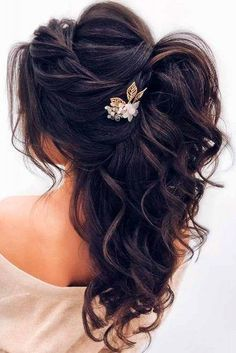 A loose waves braided half up half down wedding hair look.
