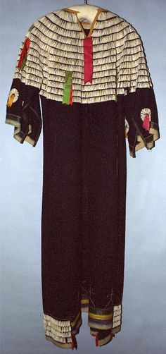 Woman's dress, Sioux, 1890-1910, Wool cloth, dentalium shell/shells, silk ribbon, sequins, metal brooches, thread. Sewn, beaded