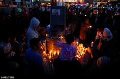 People gather at a candlelight vigil in San Diego, California, in remembrance for mass shooting victims in Orlando