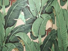We love the iconic banana leaf wallpaper from The Beverly Hills Hotel — watch our video on how to hang wallpaper!