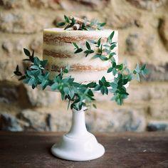 Naked wedding cake with eucalyptus foliage - Amazing cake by Vanilla Pod Bakery and image by @theresa_furey