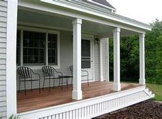 Front Porch: Painted Clapboard Siding and Raw (parallel) Wood Deck.