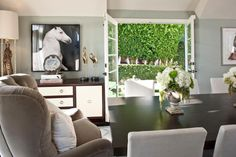Find something that's uniquely you and display front and center like designer Jennifer Dyer did with the horse mural.A transitional buffet has a high-contrast finish that fits with the room's crisp, up-to-date aesthetic, and a comfy upholstered arm chair is an unexpected touch at the head of the table.