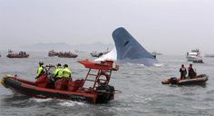 South Korean maritime police search for passengers in the sea around the sinking ferry Sewol.