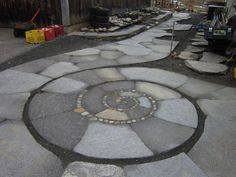 Custom Made Spiral Patio & walkway. Flagstone(concrete?) with stones in the spiral's seams
