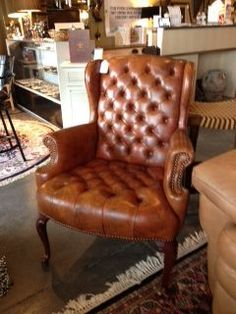 Minneapolis: Brown leather tuffed accent chair $225 - http://furnishlyst.com/listings/302037