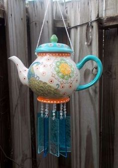 Vintage Teapot A vintage teapot serves as a colorful top for a cheerful, folksy set of wind chimes. To make your own, restring old faux pearls onto fishing line, then add flat glass pieces or even old xylophone keys to the bottom of each string. When the wind blows, you'll enjoy a sweet, tinkling tune.