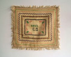 A beautiful antique cross-stitch sampler.