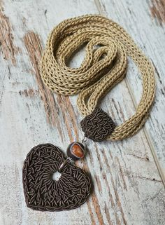 Textile necklace in cotton, viscose crochet pendant with agate stone , textile jewelry - Schmuck selbermachenNecklace in soft cotton and crochet pendant with brown agate! This new line of textile jewelry is characterized by simple […]Textilkette au Diy Jewelry Unique, Unique Necklaces, Jewelry Crafts, Delicate Jewelry, Jewelry Art, Gold Jewelry, Jewellery, Crochet Jewelry Patterns, Crochet Accessories