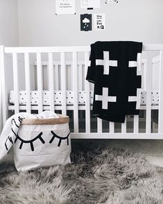 A neutral Scandinavian nursery design outfitted with Modern Burlap, including the organic muslin crib sheet in cross pattern.
