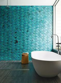 Keep up with tile trends. Fish scale tiles are a great way to update your kitchen or bathroom. Replace your subway tile with fish scale tile to stay on trend. For more design ideas and inspiration, go to Domino. Bad Inspiration, Bathroom Inspiration, Interior Inspiration, Creative Inspiration, Interior Ideas, Blue Green Bathrooms, Bathroom Green, Bathroom Modern, Minimalist Bathroom