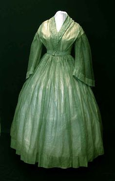 Southron Creations: 1860s Fashion - Here is an original sheer dress from the collection of K. Krewer. Sheer dresses were worn in the summer for coolness as well as fashion.  Since a lady would be wearing a chemise, corset, drawers and petticoats, there was no indecency in a see-through gown.  The delicacy of the fabric usually meant these dresses were trimmed with self-fabric as this one is, instead of having heavy trim sewn on them. They also did not have to be worn with undersleeves if a l