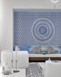 Greek living room with built in bench seating. Love the blue wall mural. Mimar Interiors. #livingroom