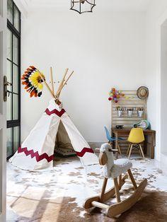 Mini #Eames shell chairs brighten up a modern kids' playroom.