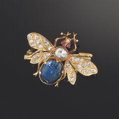A sapphire, diamond and ruby brooch