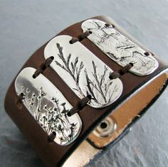 These Three, PMC OOAK Jewelry, Fine Silver and Leather Cuff, Natural Plant Impressions, Artisan Handmade Bracelet. $148.00, via Etsy.
