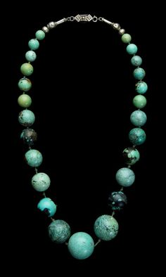 Necklace of graded turquoise matrix beads. China: Inner Mongolia, 19th c (but restrung, and with a modern clasp at top). The diameter of the largest bead is as much as 3.8 cm. Bought many years ago from Mia van Bussel (a dealer then selling excellent ethnic jewellery). Published in *Ethnic Jewellery and Adornment*, p. 280