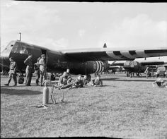 A scene at RAF Harwell, Oxfordshire, just before the start of the Airborne invasion of The Netherlands. British airborne troops wait to emplane by their Horsa glider.