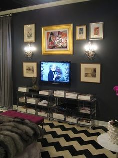 I want to do some sort of gallery wall around the television.  Love the lucite credenza too. #gallerywall #tv #television