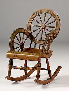 Gentil American, A Whimsical, Paint Decorated, Rocking Chair. All Original And  Likely Fashioned By A Turner Who Made Both Spinning Wheels And Chairs