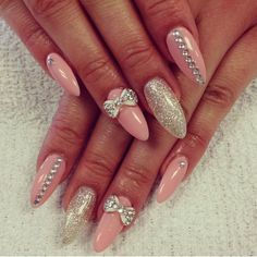 pink nail polish with strass and bow