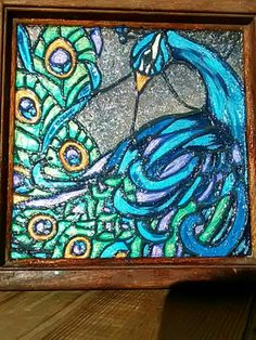 Pretty as a peacock with silicone. Faux stained glass by Julie Baker-Lowden https://www.facebook.com/MyArtsyFartsySelf