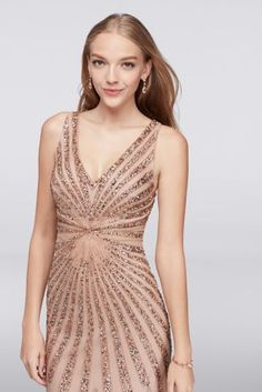 Rays of glittering beads and shining sequins set this mesh mermaid dress aglow. A V-neck and side cut-outs add more angles to the geometric design.   By Adrianna Papell  Polyester  Back zipper; fully lined  Spot clean only  Imported