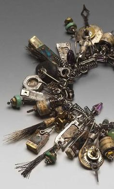 Susan Lenhart Kazner-Her pieces and found objects speak to my heart.  She is a genius.