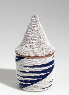 Tutsi (Rwanda), Basket, beads/plant fibers, c. 1970.  Since 1994, these are usually called peace baskets without the tribal affiliation, due to the past history of the country.