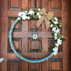 Rustic white roses bicycle wreath #texasrusticwooddecor #whiteroses #bicyclewheel #wreath #bicyclewreath #teal #roses #bikewheel #upcycle #upcycledwreath #rustichomedecor