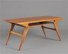 Designed by N. O. Møller sofatable made of teak and nut. Model 34