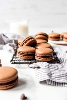 These indulgent Chocolate Macarons are filled with dark chocolate ganache and I promise they are easier to make than you would think! Don't be intimidated by this classic french dessert. Follow my tips for the best chocolate macarons that not only taste as good (if not better) than the ones from a high-end bakery, but also don't cost an arm and a leg! #macarons #french #homemade #easy #ganache #recipe #filling #withganache Chocolate Macaron Recipe, Chocolate Macaroons, Chocolate Icing, Almond Recipes, Baking Recipes, Dessert Recipes, Baking Tips, Baking Ideas, Dessert Ideas