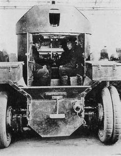 Two of the crew in a Lanchester Armored Car