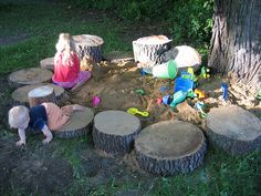 Natural sandbox surrounded by log stumps. . perfect for sitting on!