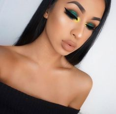 Blue eyeshadow w/ yellow inner corner and black liner