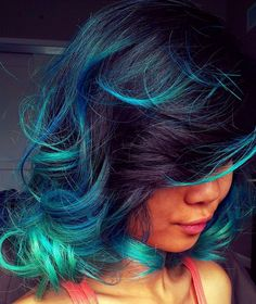 Rainbow Hair Color Ideas | POPSUGAR Beauty. Dark red hair with blue highlights.