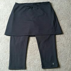 Athleta 'Exhale' 2 in 1 Skirted Capri Yoga Pants Athleta 'Exhale' 2 in 1 Skirted Capri Yoga Pants / Tights. Size Small. Color: Black. NOT faded at all. In perfect condition! No stains, rips, tears, or holes. Features attached skirt for full coverage. Small hidden pocket on right rear. 88% polyester, 12% spandex. Feel free to ask any questions. MAKE ME AN OFFER! FREE GIFT with every purchase! Bundle for further discounts. Athleta Pants Capris